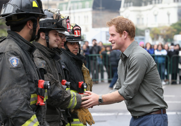 Prince Harry meets Firefighters at Valpariso Firestation on June 28, 2014 in Valpariso, Chile. Firefighters from Valpariso were involved in dealing with the devastating forest fires that hit the area in April. Prince Harry is on a three day tour of Chile after visiting Brazil.