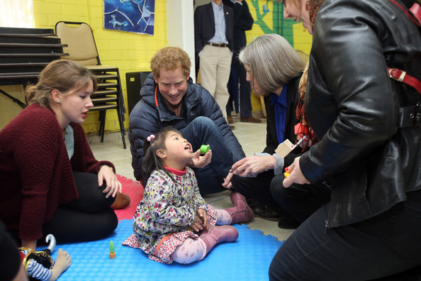 Prince Harry speaks with staff and children at the Fundacion Amigos de Jesus day care centre, where they look after children with mental and physical disabilities on June 29, 2014 in Santiago, Chile.  Prince Harry is on the final day of a three day tour of Chile after visiting Brazil.