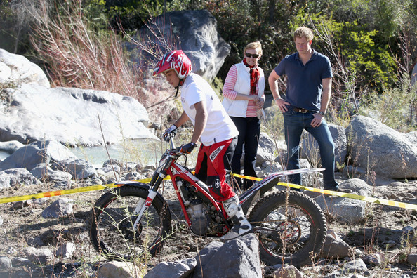 Prince Harry watches trail bike riders during a visit to an outdoor centre on June 29, 2014 in Antaeaya, Chile. Prince Harry is on the final day of a three day tour of Chile after visiting Brazil.