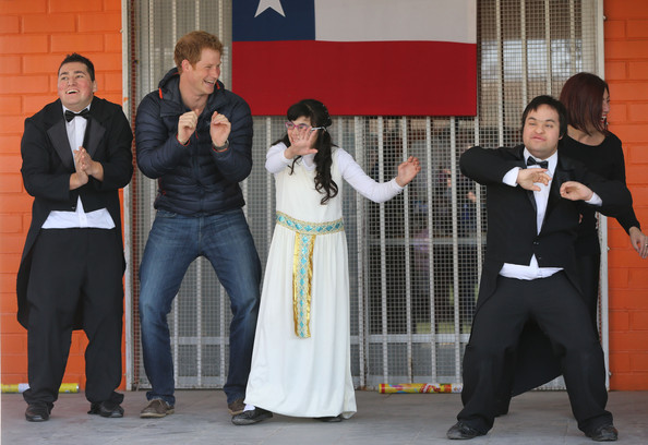 Prince Harry dances with children at the Fundacion Amigos de Jesus day care centre on June 29, 2014 in Santiago, Chile.  Prince Harry is on the final day of a three day tour of Chile after visiting Brazil.