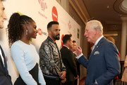 Prince Charles, Prince of Wales greets Dina Asher-Smith and Craig David as he attends the Prince's Trust And TK Maxx & Homesense Awards at London Palladium on March 11, 2020 in London, England.