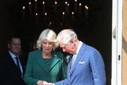 Prince Charles, Prince of Wales lends a hand to Camilla, Duchess of Cornwall during the reopening of Hillsborough Castle on April 09, 2019 in Belfast, Northern Ireland.