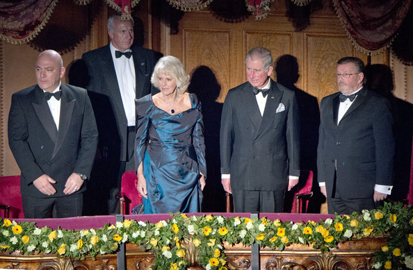 Prince Charles, Prince of Wales and Camilla, Duchess of Cornwall stand for the national anthem at the Royal Variety Performance at London Palladium on November 25, 2013 in London, England.
