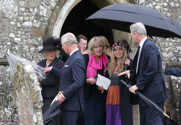 (L-R) Prince Charles, Prince of Wales, Camilla, Duchess of Cornwall, Annabel Elliott and Mark Shand's daughter Ayesha Shand follow the coffin of Mark Shand as it leaves Holy Trinity Church in Stourpaine on May 1, 2014 near Blandford Forum in Dorset, England.  Conservationist and travel writer Mr Shand, who is the brother of Camilla, Duchess of Cornwall, died unexpectedly last week after falling and hitting his head in New York.