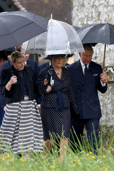 (L-R) Laura Lopes, Camilla, Duchess of Cornwall, and Prince Charles, Prince of Wales arrive for Mark Shands funeral at Holy Trinity Church in Stourpaine on May 1, 2014 near Blandford Forum in Dorset, England.  Conservationist and travel writer Mr Shand, who is the brother of Camilla, Duchess of Cornwall, died unexpectedly last week after falling and hitting his head in New York.