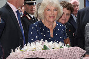 Camilla, Duchess Of Cornwall during a visit to the Vasari Corridor on day three of her tour of Italy on April 2, 2017 in Florence, Italy.  Designed by Giorgio Vasari and built by Grand Duke Cosimo I de'Medici in 1565, the Vasari Corridor connects the gallery of statues and paintings in the Uffizi Gallery to Palazzo Pitti and was built to allow the Grand Dukes of Florence to move safely from their private residence at Palazzo Pitti to the government's headquarters at Palazzo Vecchio.
