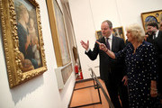 Camilla, Duchess Of Cornwall is shown around by Dr Eike Schmidt, director of the Uffuzi Gallery, during a visit to the Vasari Corridor on day three of her tour of Italy on April 2, 2017 in Florence, Italy.  Designed by Giorgio Vasari and built by Grand Duke Cosimo I de'Medici in 1565, the Vasari Corridor connects the gallery of statues and paintings in the Uffizi Gallery to Palazzo Pitti and was built to allow the Grand Dukes of Florence to move safely from their private residence at Palazzo Pitti to the government's headquarters at Palazzo Vecchio.