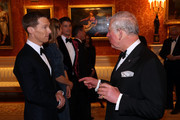 Benedict Cumberbatch speaks with Prince Charles, Prince of Wales during a dinner to celebrate 'The Princes Trust' at Buckingham Palace on March 12, 2019 in London, England. The Prince of Wales, President, The Prince's Trust Group hosted a  dinner for donors, supporters and ambassadors of Prince's Trust International.