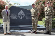 Prince Charles, Prince of Wales poses next to a memorial during a visit to the Welsh Guards at Combermere Barracks on May 5, 2021 in Windsor, England.