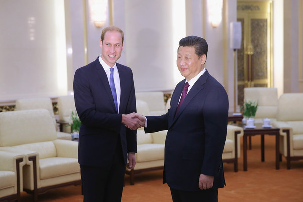 Prince William (L-R) Prince William, Duke of Cambridge shakes hands with Chinese President Xi Jinping at the Great Hall of the People on March 2, 2015 in Beijing, China. The Duke of Cambridge is on a three-day visit to China. He is the first senior British royal to visit China since the Queen and Prince Philip visited in 1986.