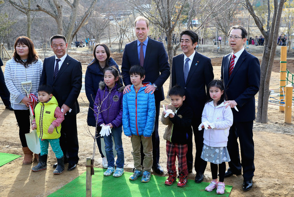 Prince William Prince William, Duke of Cambridge and Japanese Prime Minister Shinzo Abe (blue tie) visit Smile Kid's Park on February 28, 2015 in Koriyama, Japan. The Duke of Cambridge is visiting Japan from February 26th to March 1st 2015.
