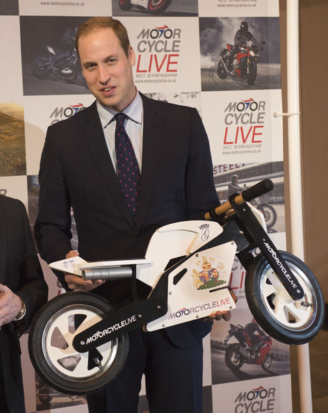 Prince William Prince William, Duke of Cambridge receives a mini motorcycle as a gift for his son Prince George, during a visit to Motorcycle Live at the National Exhibition Centre, where he toured the stands and watched a live motorcycle display on November 30, 2013 in Birmingham, United Kingdom.