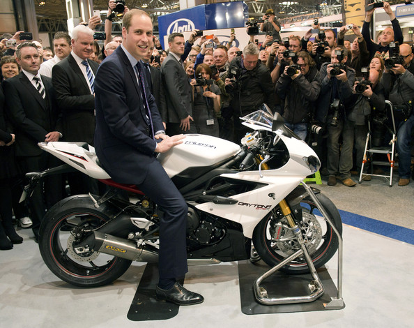 Prince William Prince William, Duke of Cambridge sits on a Triumph Daytona during a visit to Motorcycle Live at the National Exhibition Centre, where he toured the stands and watched a live motorcycle display on November 30, 2013 in Birmingham, United Kingdom.