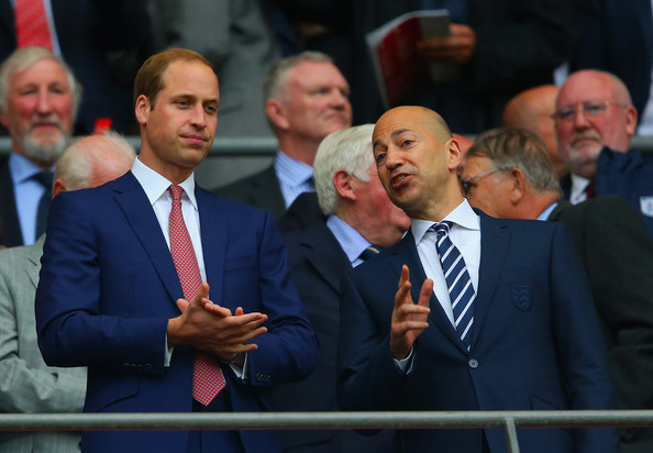 Prince William Prince William, Duke of Cambridge speaks to Ivan Gazidis chief executive of Arsenal applaud during the international friendly match between England and Peru at Wembley Stadium on May 30, 2014 in London, England.