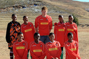 Prince Harry poses for a photo with his team before playing in a football match during a visit to a child education centre on June 17, 2010 in Semonkong, Lesotho. The two Princes are on a joint trip to Africa which takes in Botswana, Lesotho and finally South Africa. During that time they will visit a number of projects supported by their respective charities Sentebale (Prince Harry) and Tusk Trust (Prince William). The trip will culminate with the brothers watching the England vs Algeria World Cup match in Cape Town.
