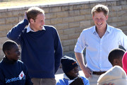 Prince Harry and Prince William take part in a game with HIV affected children at the Mamahato Network Club at King Letsie's Palace on June 17, 2010 in Maseru, Lesotho. The two Princes are on a joint trip to Africa which takes in Botswana, Lesotho and finally South Africa. During that time they will visit a number of projects supported by their respective charities Sentebale (Prince Harry) and Tusk Trust (Prince William). The trip will culminate with the brothers watching the England vs Algeria World Cup match in Cape Town.