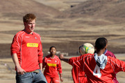 Prince Harry plays in a football match during a visit to a child education centre on June 17, 2010 in Semonkong, Lesotho. The two Princes are on a joint trip to Africa which takes in Botswana, Lesotho and finally South Africa. During that time they will visit a number of projects supported by their respective charities Sentebale (Prince Harry) and Tusk Trust (Prince William). The trip will culminate with the brothers watching the England vs Algeria World Cup match in Cape Town.