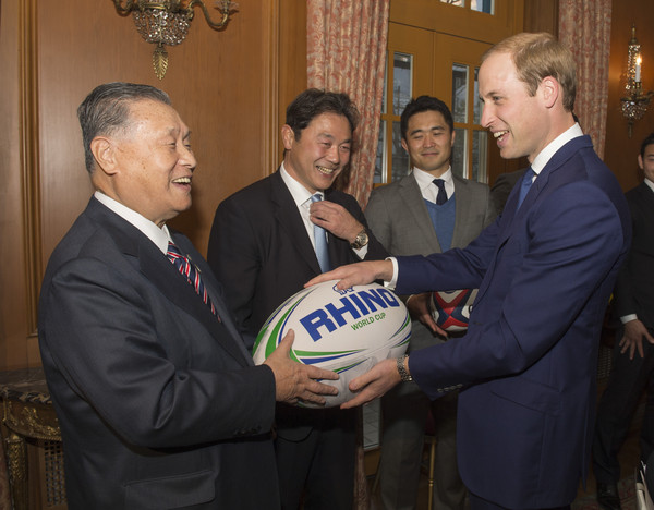 Prince William Former Japanese Prime Minister Yoshiro Mori Presents a large Rugby ball to Prince William, Duke of Cambridge at a reception at the British Embassy, given by the Ambassador, where he met high profile Japanese figures including politicians, artists, young leaders, sportsmen and other leaders in their field on February 27, 2015 in Tokyo, Japan. The Duke of Cambridge is visiting Japan from February 26th to March 1st 2015.