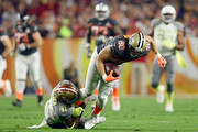 Team Carter safety Antoine Bethea #41 of the San Francisco 49ers hauls down Team Irvin tight end Jimmy Graham #80 of the New Orleans Saints  during the first half of the 2015 Pro Bowl at University of Phoenix Stadium on January 25, 2015 in Glendale, Arizona.