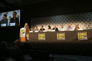 (L-R) Moderator Laura Prudom, actors Aidan Gillen, Michael Malarkey, Laura Mennell, Neal McDonough, executive producers David O'Leary, Sean Jablonski, and Jackie Levine attend the Project Blue Book panel at Comic-Con International on July 21, 2018 in San Diego, California.
