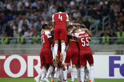 Arsenal players celebrate after their team's first goal during the UEFA Europa League Group E match between Qarabag FK and Arsenal at  on October 4, 2018 in Baku, Azerbaijan.