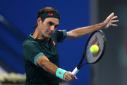 Roger Federer of Switzerland returns a backhand in his match against Dan Evans of Great Britain on Day 3 of the Qatar ExxonMobil Open at Khalifa International Tennis and Squash Complex on March 10, 2021 in Doha, Qatar.
