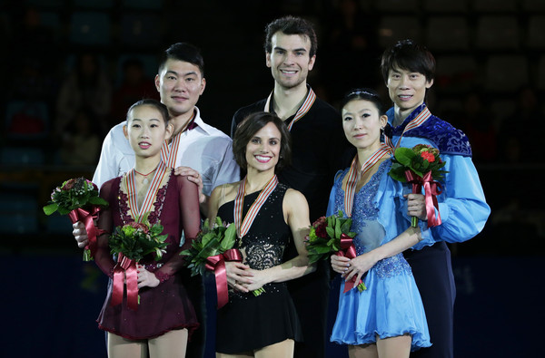 ISU Four Continents Figure Skating Championships 2015 - Day Three [event,ceremony,performance,recreation,team,performing arts,flower,cheng peng,qing pang,meagan duhamel,r,place,podium,china,canada,isu four continents figure skating championships,medals ceremony]