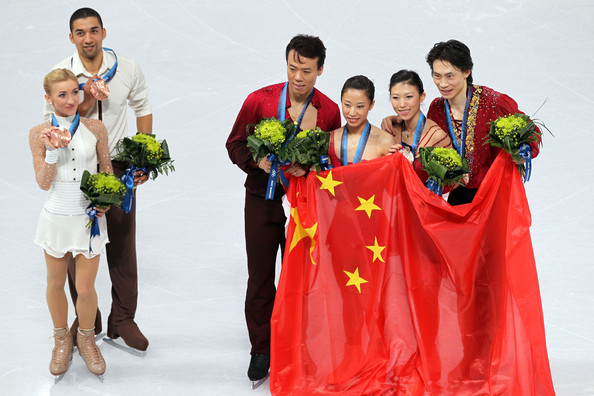Vancouver 2010 Winter Olympics at the UBC Thunderbird Arena [fashion,event,tradition,recreation,costume,dress,ceremony,figure skating,l-r,bronze medal,gold medal,silver medal,china,germany,aliona savchenko,robin szolkowy,qing pang]