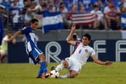Andy Najar #14 of Honduras battles for the ball against Juan Diego Madrigal #6 of Costa Rica during the 2013 CONCACAF Gold Cup quarterfinal game at M&T Bank Stadium on July 21, 2013 in Baltimore, Maryland.