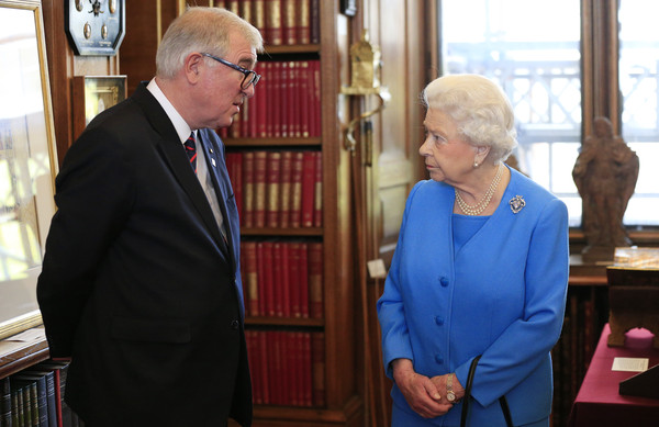 Queen Elizabeth II meets Professor Edward Byrne, President of Kings College London, while attending the launch of the George III Project at an event held in the Royal Library in Windsor Castle on April 1, 2015 in Windsor, England.