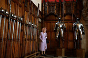 EDINBURGH, UNITED KINGDOM- JULY 03:  Queen Elizabeth II enters the Great Hall at Edinburgh Castle to meet those associated with the Memorial after attending a commemorative service for the Scottish National War Memorial at Edinburgh Castle on July 3, 2014 in Edinburgh, Scotland, United Kingdom.