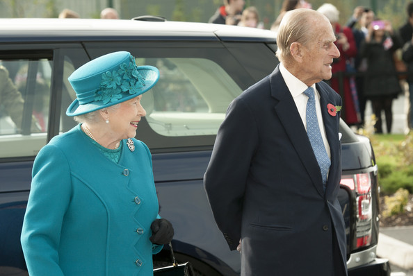 Queen Elizabeth II and Prince Philip, Duke of Edinburgh during an official visit to International Security Printers to view their work on specialist postage stamps on October 30, 2014 in Wolverhampton, England.