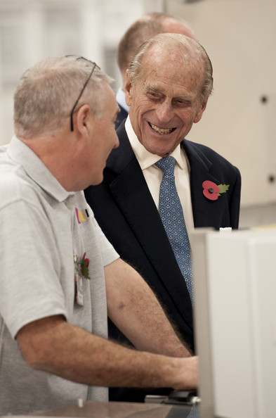 Prince Philip, Duke of Edinburgh speaks to staff during an official visit to International Security Printers to view their work on specialist postage stamps on October 30, 2014 in Wolverhampton, England.