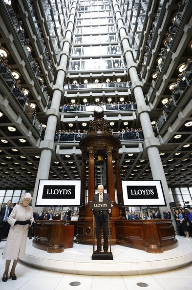 Queen Elizabeth II listens to a speech by Lloyd's Chairman John Frederick Nelson as she visits the Lloyds of London building on March 27, 2014 in London, England.