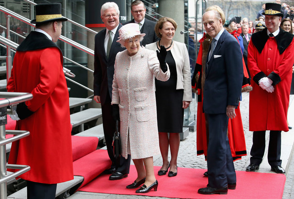 Queen Elizabeth II and Prince Phillip, Duke of Edinburgh arrive at the Lloyds of London building in the City of London on March 27, 2014 in London, England.