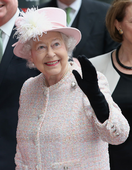 Queen Elizabeth II waves as she arrives at the Lloyds of London building in the City of London on March 27, 2014 in London, England.