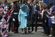 Britain's Queen Elizabeth II (centre left) and Britain's Prince Philip, Duke of Edinburgh (centre right) are greeted by well-wishers as they arrive at Mayflower Primary School during a visit to Poplar in Tower Hamlets in East London on June 15, 2017, as part of commemorations to mark the centenary of the bombing of Upper North Street School during the First World War..Mayflower Primary School now exists on the site of the Upper North Street School. / AFP PHOTO / POOL / Daniel LEAL-OLIVAS