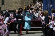 Britain's Queen Elizabeth II (C) and Britain's Prince Philip, Duke of Edinburgh (centre left) are greeted by well-wishers as they arrive at Mayflower Primary School during a visit to Poplar in Tower Hamlets in East London on June 15, 2017, as part of commemorations to mark the centenary of the bombing of Upper North Street School during the First World War..Mayflower Primary School now exists on the site of the Upper North Street School. / AFP PHOTO / POOL / Daniel LEAL-OLIVAS