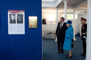 Queen Elizabeth II accompanied by Prince Philip, The Duke of Edinburgh, visits the Chapel to view the restoration and meet local people involved with the project at the Royal Dockyard Chapel during an official visit on April 29, 2014 in Pembroke Dock, United Kingdom. This year sees the 200th anniversary of the town of Pembroke Dock. The Royal Dockyard Chapel has undergone a restoration project to become the base for Pembroke Dock's Heritage Centre which celebrates 200 years of a unique naval and military community.