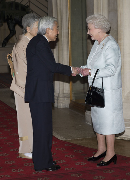Queen Elizabeth II greets Emperor Akihito of Japan and Empress Michiko as they arrive at a lunch for Sovereign Monarch's held in honour of Queen Elizabeth II's Diamond Jubilee, at Windsor Castle, on May 18, 2012 in Windsor, England.