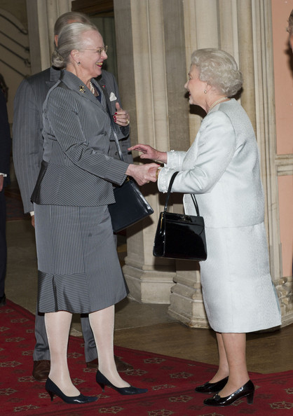 Queen Elizabeth II greet  Queen Margrethe of Denmark as she arrives at a lunch for Sovereign Monarch's held in honour of Queen Elizabeth II's Diamond Jubilee, at Windsor Castle, on May 18, 2012 in Windsor, England.