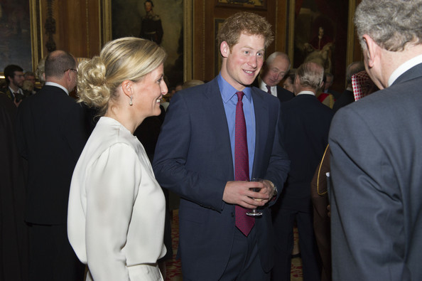 Sophie countess of Wessex and Prince Harry speak with guests during a reception in the Waterloo Chamber, before the Lunch For Sovereign Monarchs at Windsor Castle, on May 18, 2012 in Windsor, England.