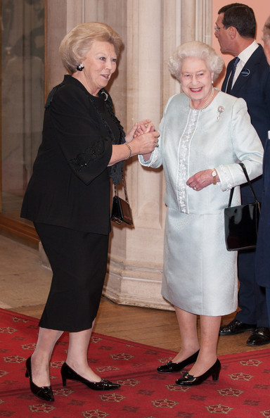 Beatrix; Queen of the Netherlands is greeted by Queen Elizabeth II as he arrives at a lunch for Sovereign Monarch's held in honour of Queen Elizabeth II's Diamond Jubilee, at Windsor Castle, on May 18, 2012 in Windsor, England.