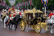 Queen Elizabeth II returns to Buckingham Palace in the new Diamond Jubilee state coach following the State Opening of Parliament on June 4, 2014 in London, England. Queen Elizabeth II unveiled the coalition government's legislative programme in a speech delivered to Members of Parliament and Peers in The House of Lords. Proposed legislation is expected to be introduced on a 5p charge for plastic bags in England, funding of workplace pensions, new state-funded childcare subsidy and reforms to speed up infrastructure projects.