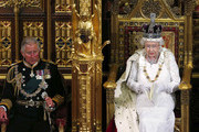 Queen Elizabeth II sits with Prince Charles, Prince of Wales as she delivers her speech during the State Opening of Parliament in the House of Lords at the Palace of Westminster on June 4, 2014 in London, England. Queen Elizabeth II is to unveil the coalition government's legislative programme in a speech delivered to Members of Parliament and Peers in The House of Lords. Proposed legislation is expected to be introduced on a 5p charge for plastic bags in England, funding of workplace pensions, new state-funded childcare subsidy and reforms to speed up infrastructure projects.