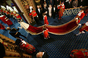 Queen Elizabeth II and the Prince Philip, Duke of Edinburgh proceed through the Royal Gallery during the State Opening of Parliament in the House of Lords at the Palace of Westminster on June 4, 2014 in London, England. Queen Elizabeth II is to unveil the coalition government's legislative programme in a speech delivered to Members of Parliament and Peers in The House of Lords. Proposed legislation is expected to be introduced on a 5p charge for plastic bags in England, funding of workplace pensions, new state-funded childcare subsidy and reforms to speed up infrastructure projects.
