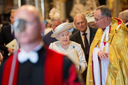 Queen Elizabeth II and Prince Philip, Duke of Edinburgh walk with the Dean of Westminster at a service to celebrate the 60th anniversary of the Coronation of Queen Elizabeth II at Westminster Abbey Dr John Hall, on June 4, 2013 in London, England.