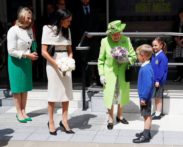 The Duchess Of Sussex Undertakes Her First Official Engagement With Queen Elizabeth II [duchess of sussex undertakes her first official engagement with,white,green,fashion,yellow,lady,event,fun,street fashion,footwear,headgear,elizabeth ii,meghan markle,harry,pair,the storyhouse,chester town hall,sussex,road bridge,the duchess]