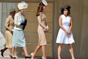 (L-R) Anne, Princess Royal, Catherine, Duchess of Cambridge and Princess Eugenie of York talk during a garden party held at Buckingham Palace on June 10, 2014 in London, England.