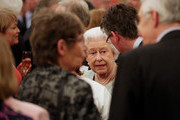 Queen Elizabeth II speaks to guests during her reception to celebrate the patronages & affiliations of the Earl and Countess of Wessex at Buckingham Palace on February 10, 2015 in London, England